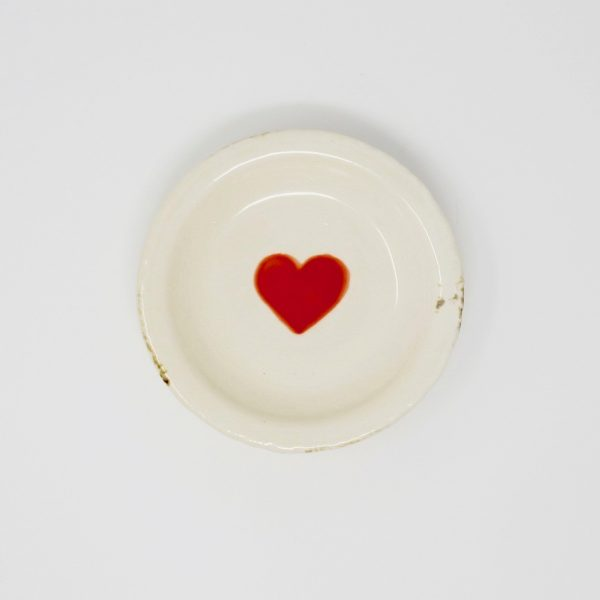 White trinket dish with red heart stamp