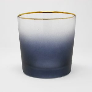 Gray ombre glass votive holder with gold rim