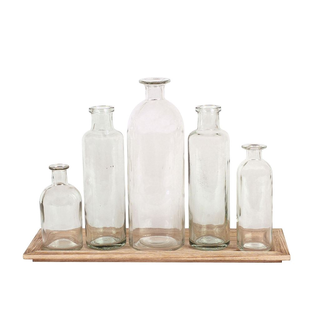 Wood tray with five glass bottles for holding flowers