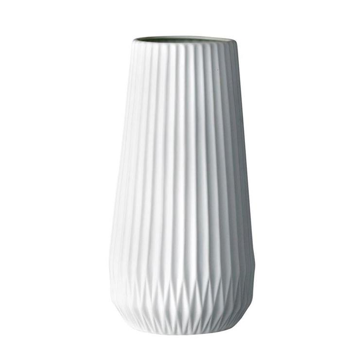 White fluted flower vase with geometric carving