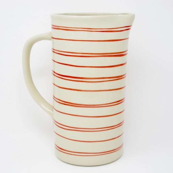 Cream water pitcher with handpainted red stripes