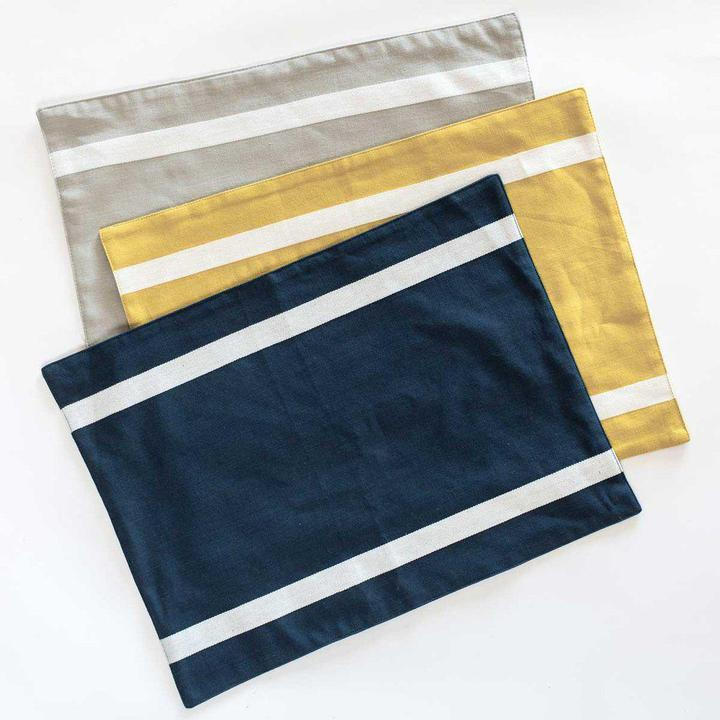 Organic Cotton Striped Placemat in navy, yellow, or gray.