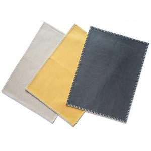 Organic Cotton Placemat in solid navy, yellow, and gray.