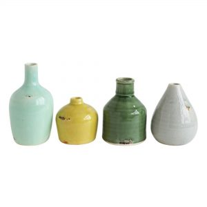 Terra cotta vase set in blue, green, yellow, and gray