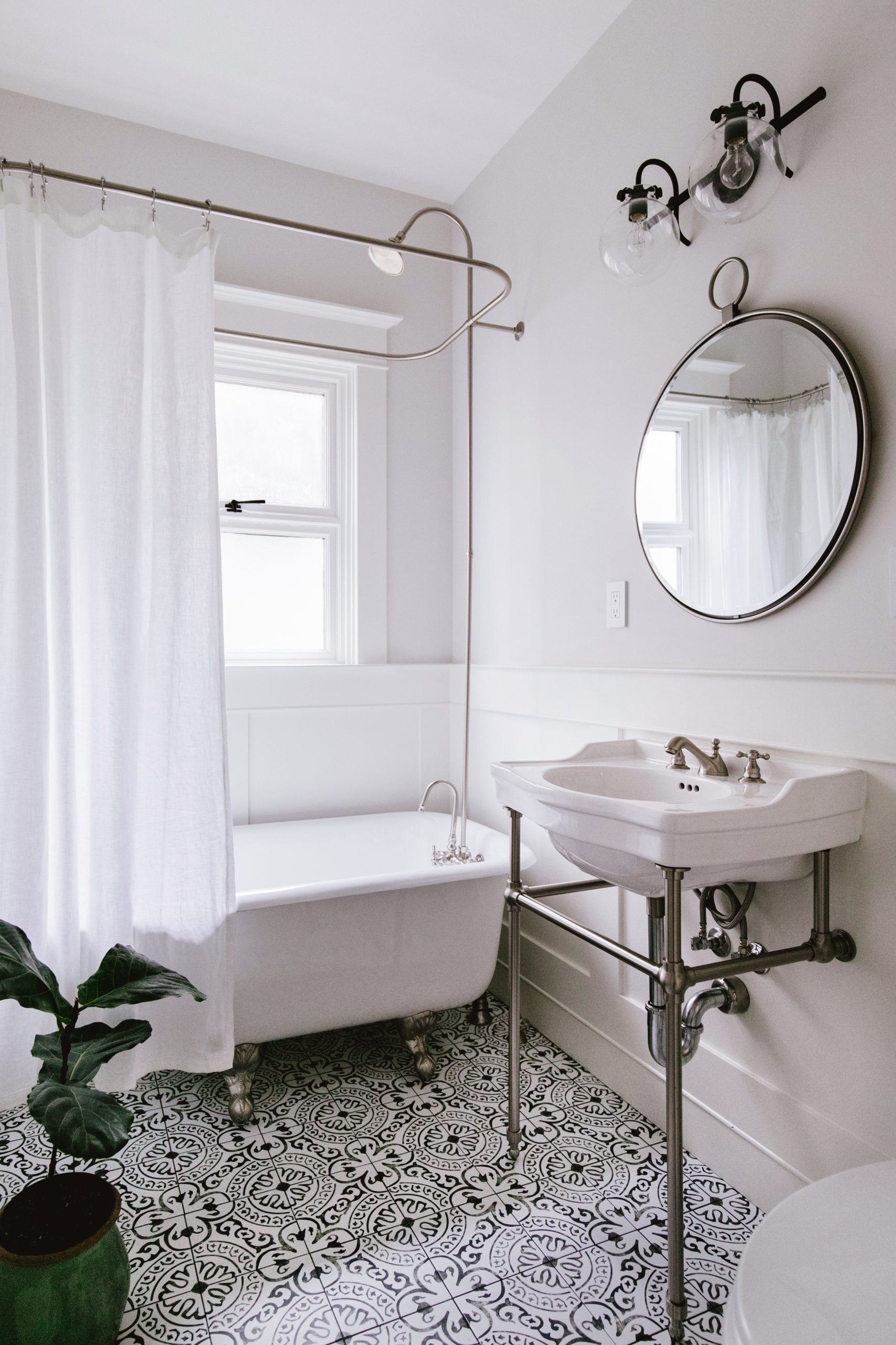Vintage white bathroom with black and white tile