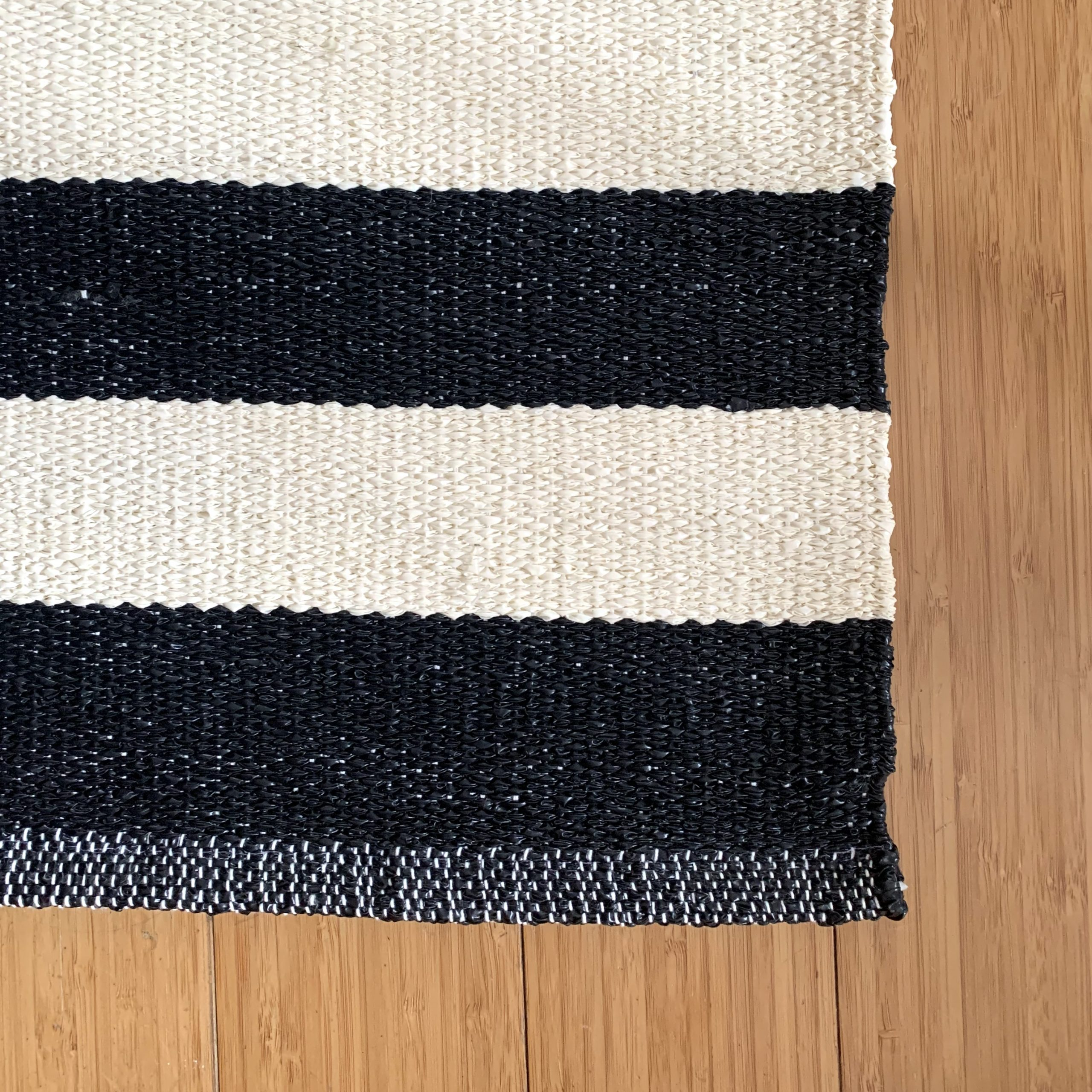 black and white striped indoor:outdoor rug